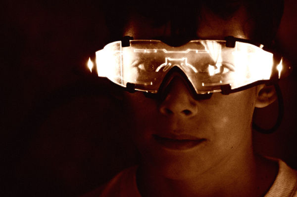 boy in glowing spy glasses