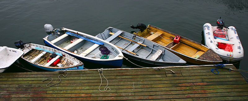 boats lined up at a dock