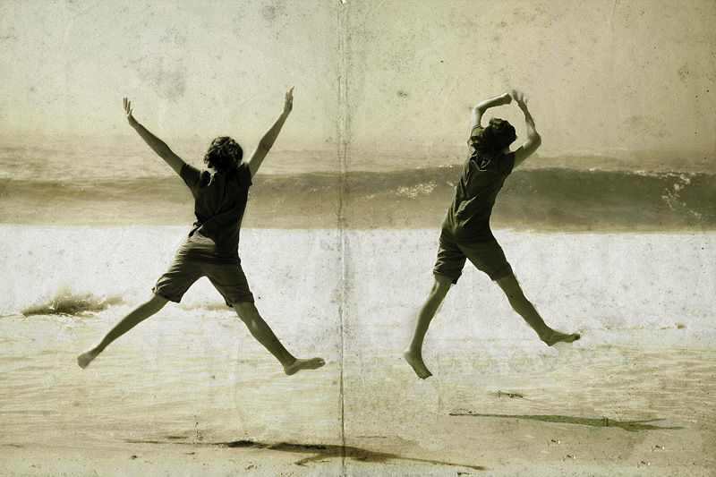 a girl jumping at the beach