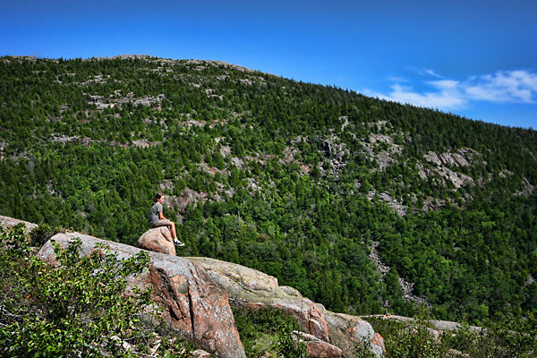 girl sitting on rock at Acadia National Park
