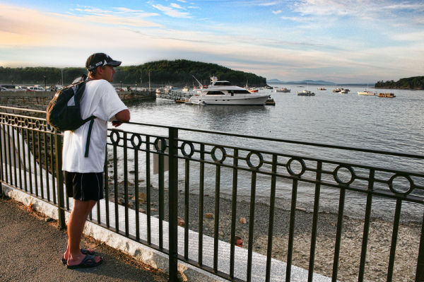 man looking out on the water in Bar Harbor, Maine