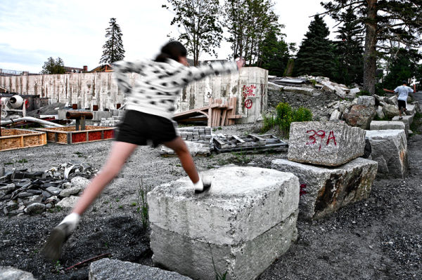 girl jumping at a construction site