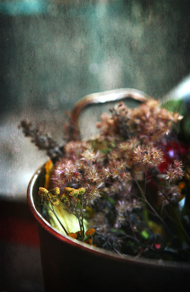 a bucket full of dried flowers