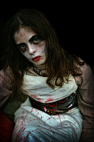 girl dressed like a zombie for Halloween