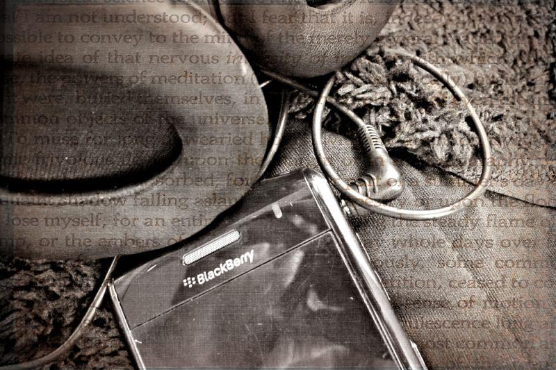 blackberry phone and headphones