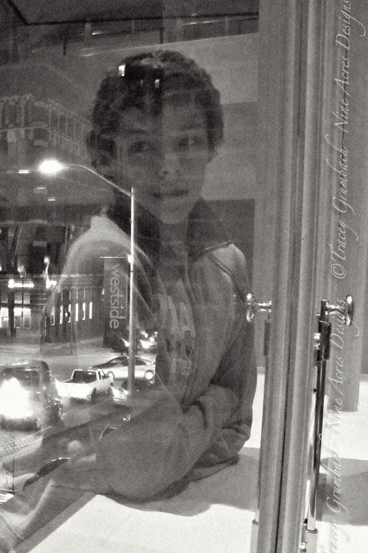 reflection of teenager in window