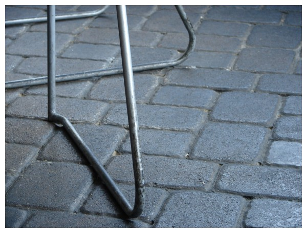 Metal Chairs on bricks at a small town cafe patio