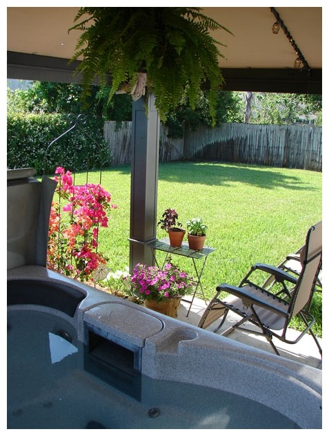 Backyard with flowers and a hot tub