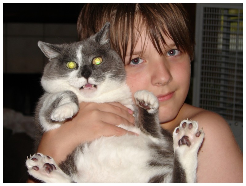 Thomas holding our cat Lovey
