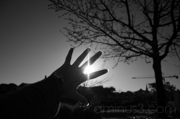 a hand reaching for the light