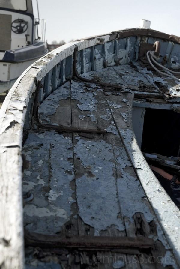 weather worn peeling paint wooden boat Holy Island