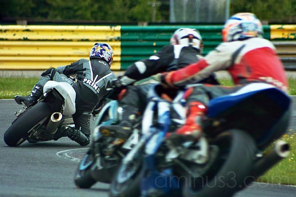 motorbikes racing around a track circuit