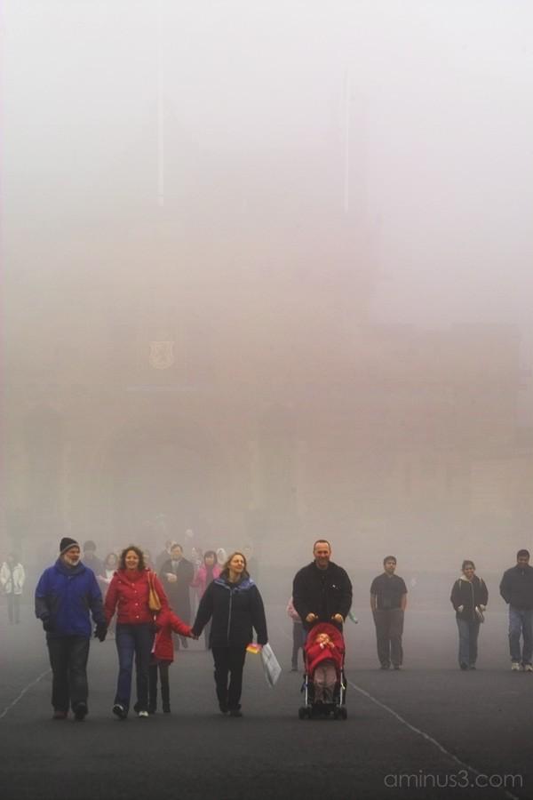 Visitors leaving Edingburgh Castle in the fog