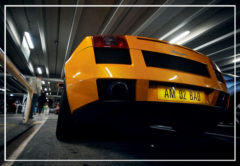 orange lambo in a car park