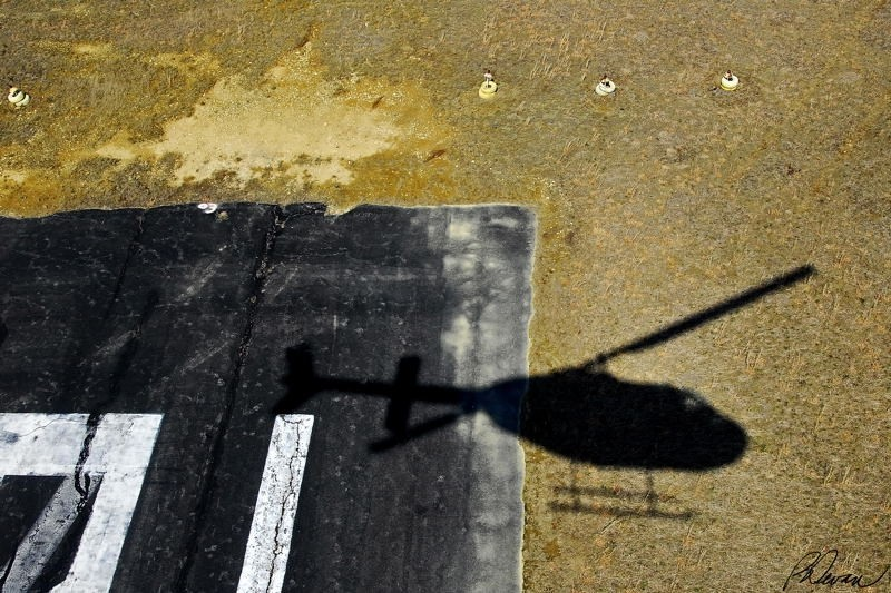 Shadow of helicopter landing at airport