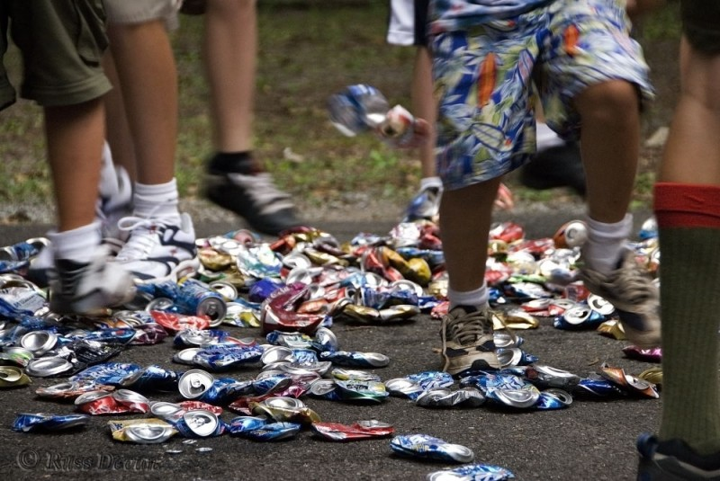 boy scouts crushing aluminum cans