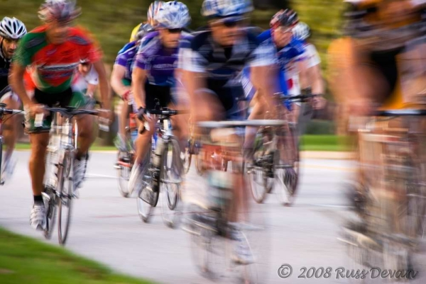 group of cyclists racing together