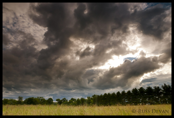 Storm Clouds Over Hay Field
