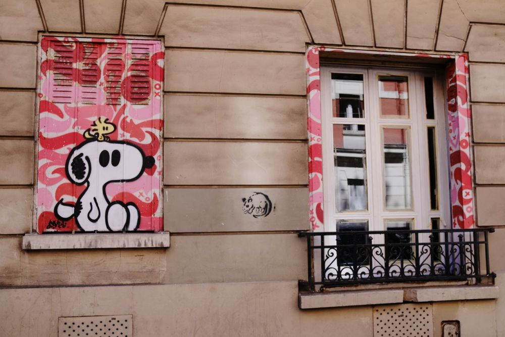 A cheerful window with Snoopy on Tuesday