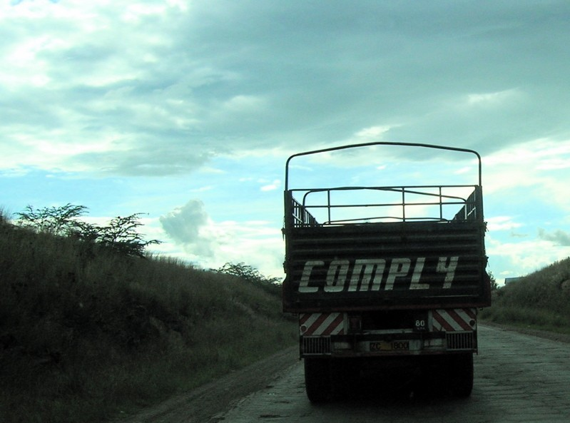 Truck on a Kenyan road at dusk