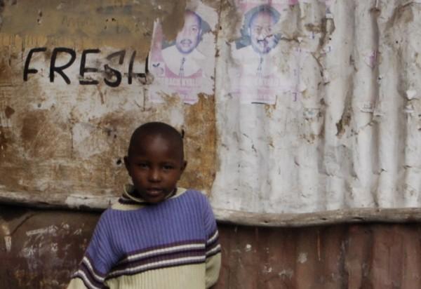Nairobi child watching a street show