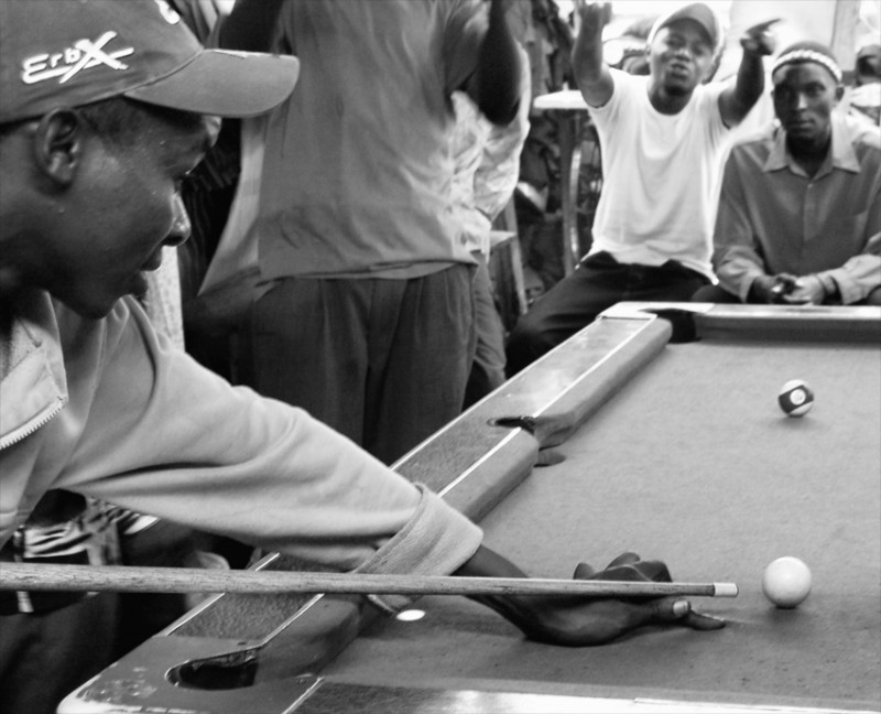 Young men playing pool in Nairobi market area