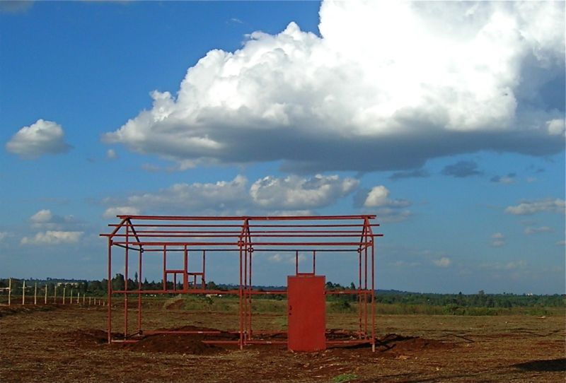 Red beams for shed in a field