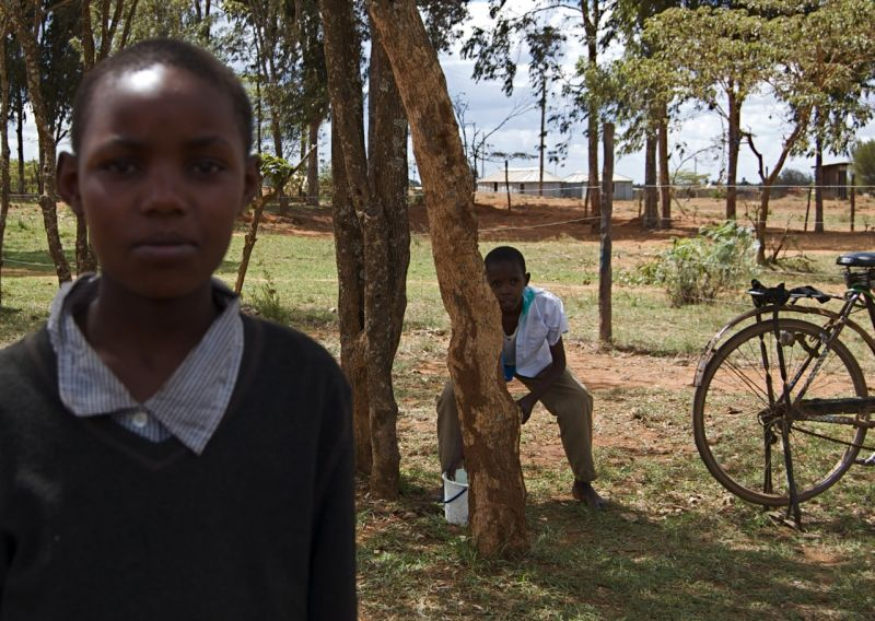Two boys & bike, KidsLibs library, Sipili Kenya