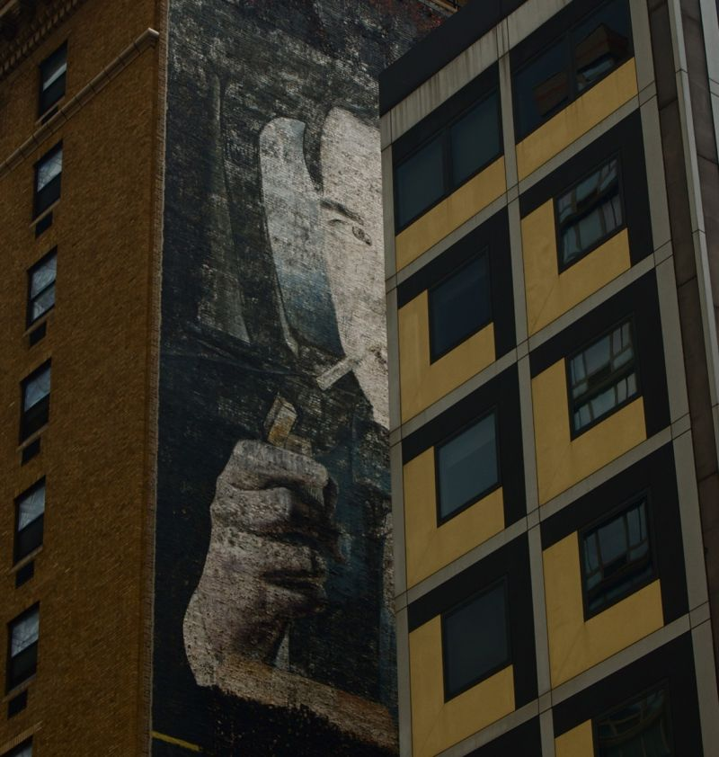 Wall painting of an elegant smoker, NYC