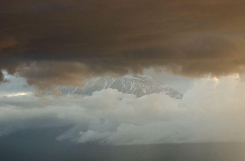 Mount Kilimanjaro through the clouds