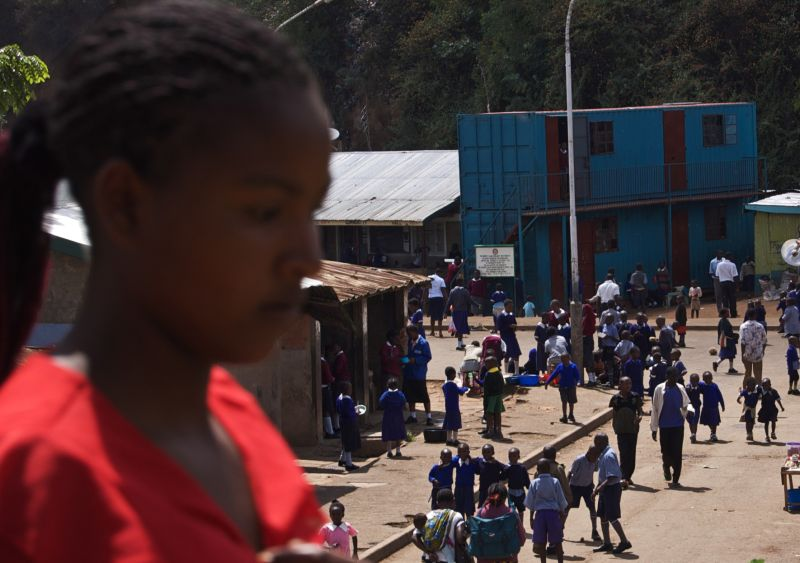 Young woman walking in Mathare Valley, Nairobi