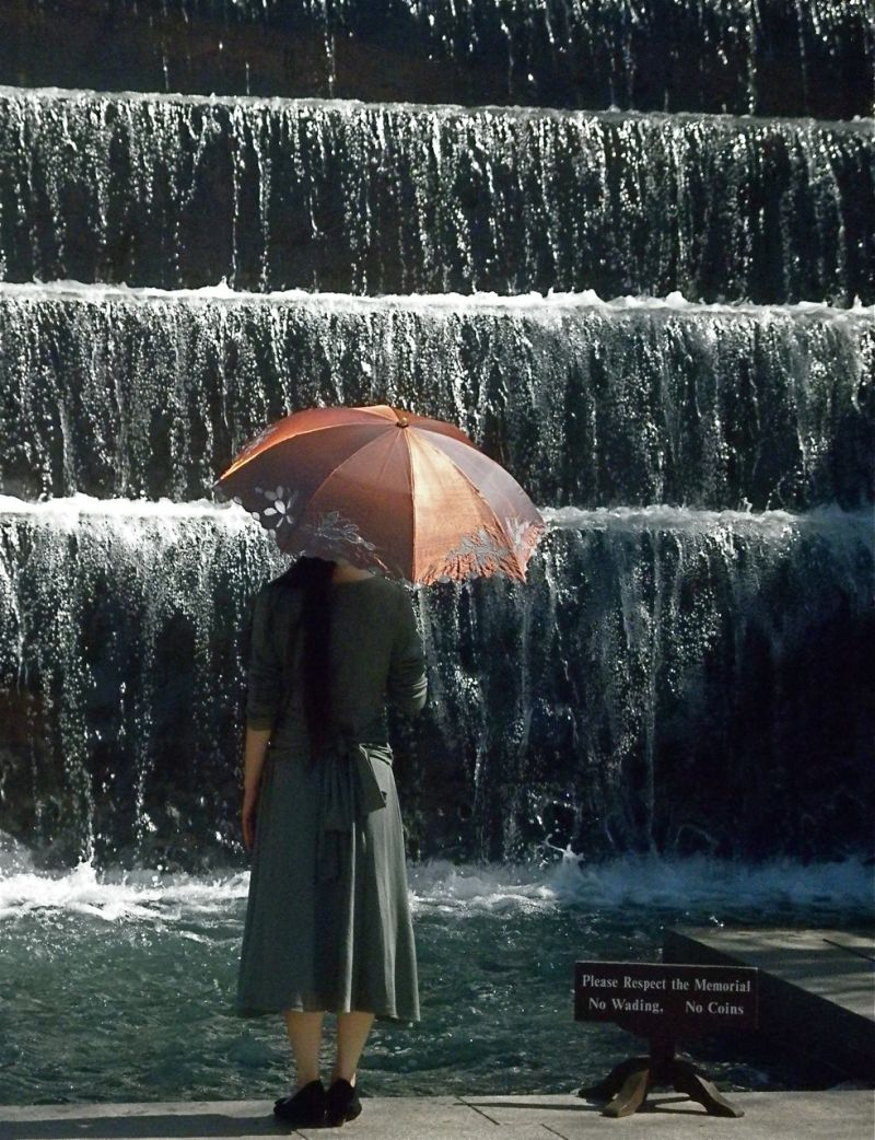 Young Japanese woman with parasol at FDR Memorial