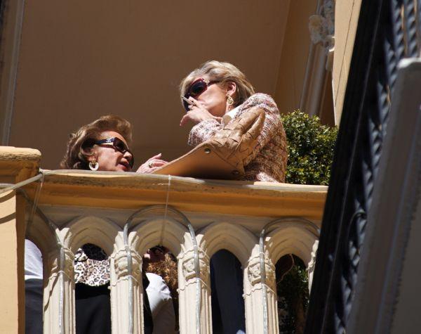 Two women watch a Las Fallas Parade, Valencia