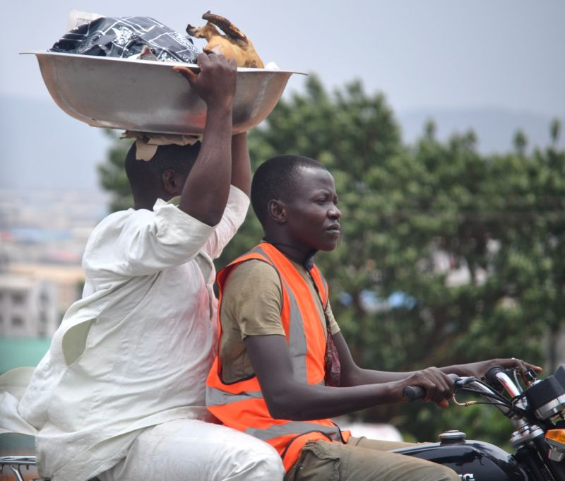 Motorcycle cab passenger with basin and chicken
