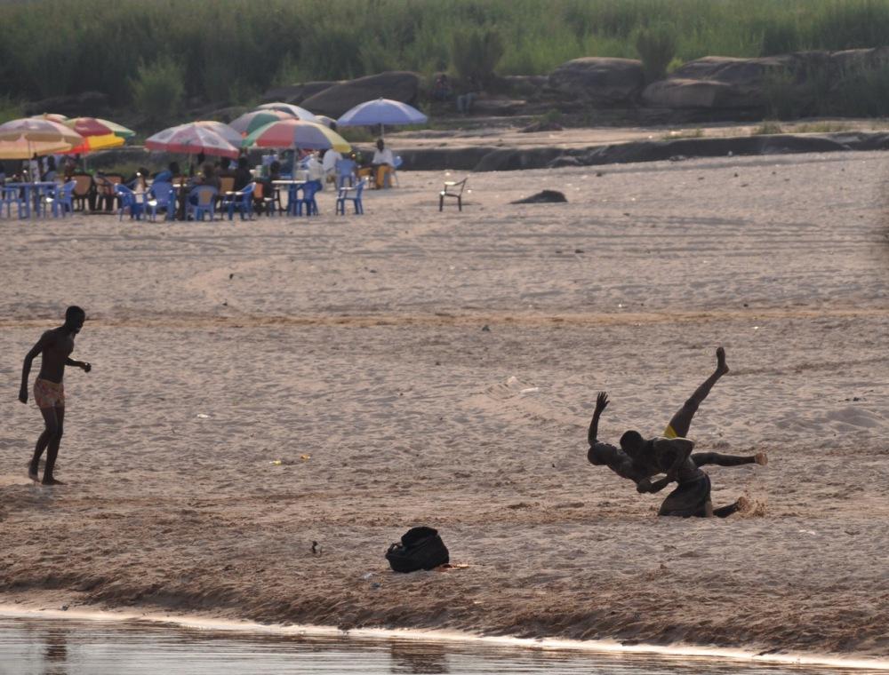 Rough-housing on the beach, Brazzaville