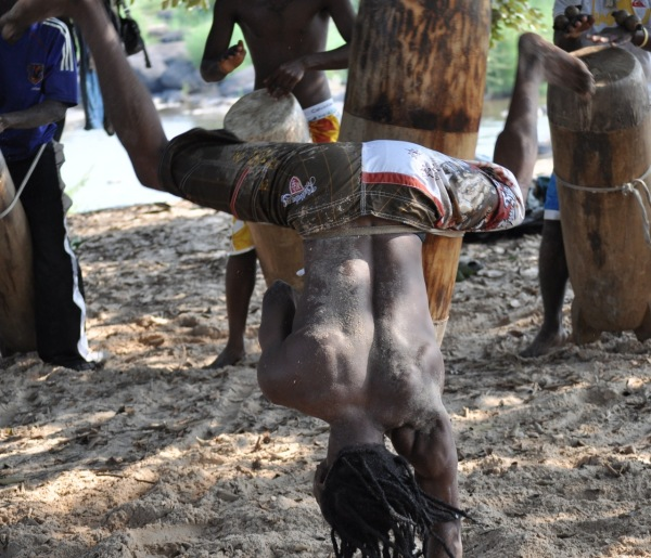 Drummer, dancing with his drum, Brazzaville