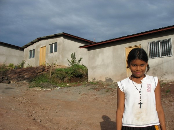 Child outside her new house, San Pedro, Chinandega