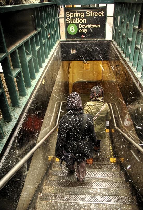 girls walk into subway station