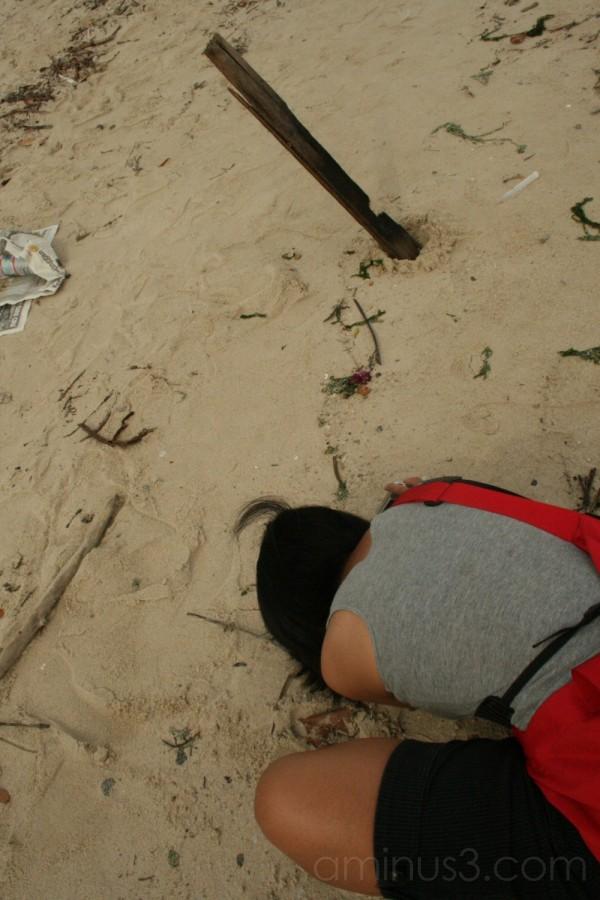 praying, changi beach.