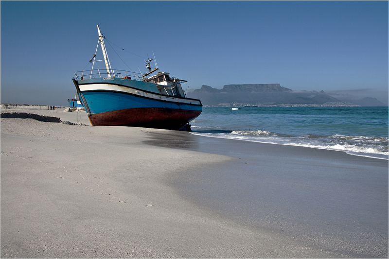 Cape Town is the place where I live. It's one of the most beautiful cities in the world, with a wide variety of natural beauty - Table Mountain, the sea, the vineyards - the list just goes on and on. Yet amongst the beauty, is the danger, and many a ship has ended up stranded like these two, beacuse of the treacherous storms along our coastline.