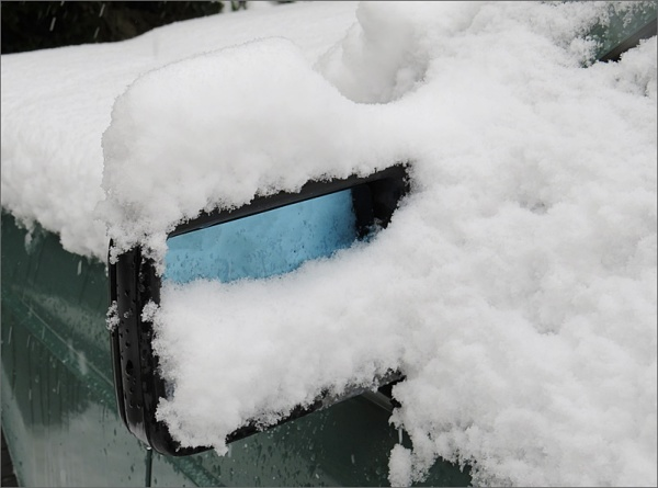 snow-covered mirror
