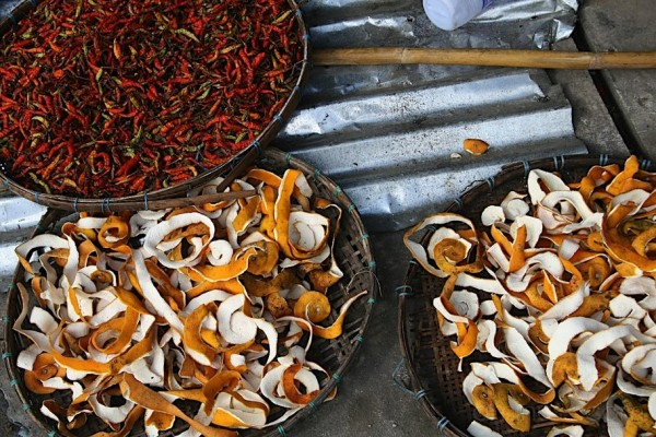 Fruit and peppers drying in baskets, Luang Prabang