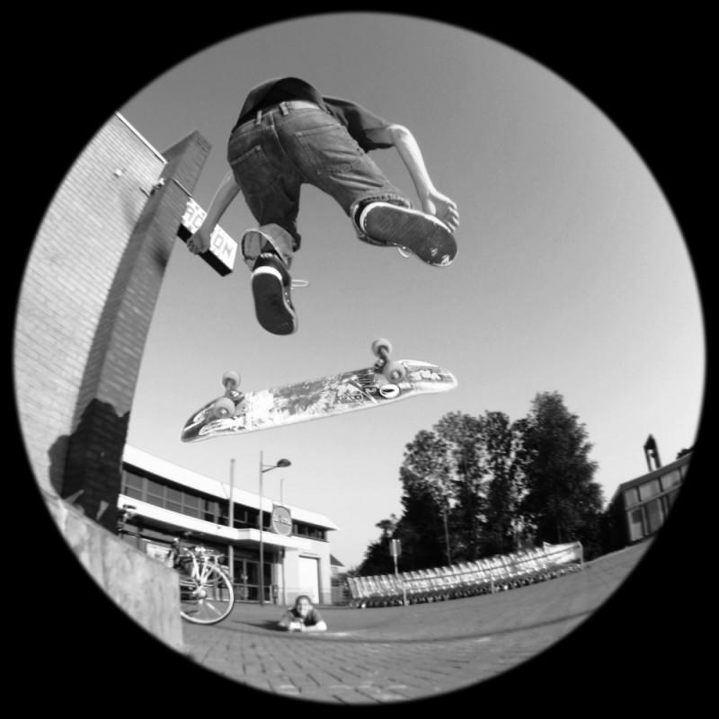 Skater doing a kickflip.