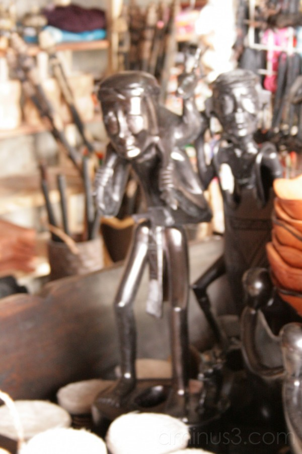 Wooden sculpture of an igorot hunting for food