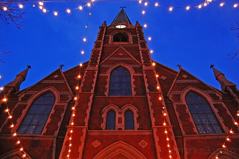 Church with christmas lights at dusk