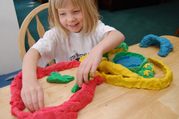 Tirzah building with Play-doh