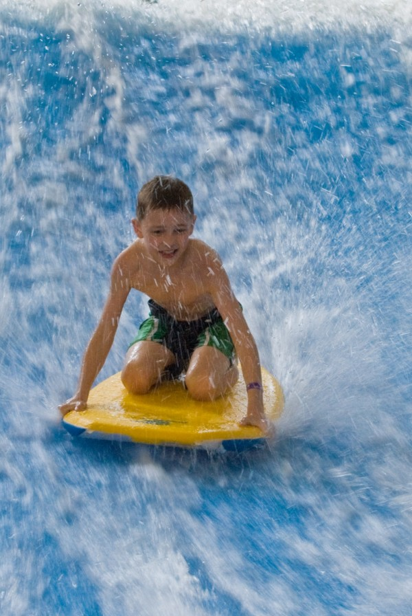 Ethan surfing at the waterpark
