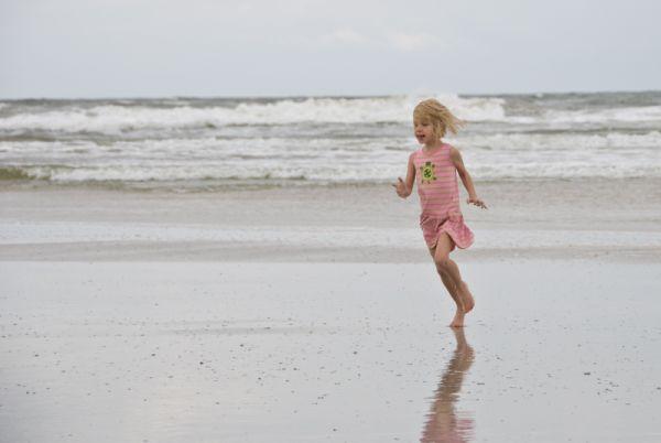 Tirzah runs on the beach in Florida