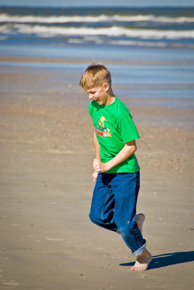 Ethan running on the beach