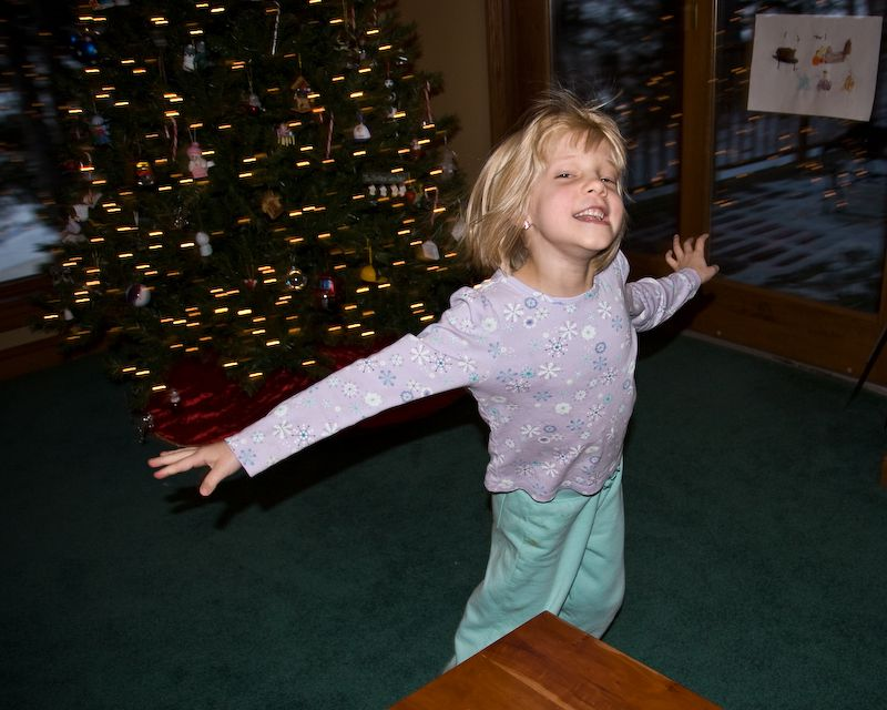 Tirzah dancing around the Christmas Tree